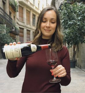 Gabriela pouring wine